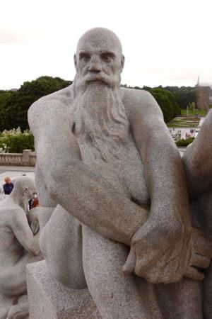 Granite statue of bearded older man
