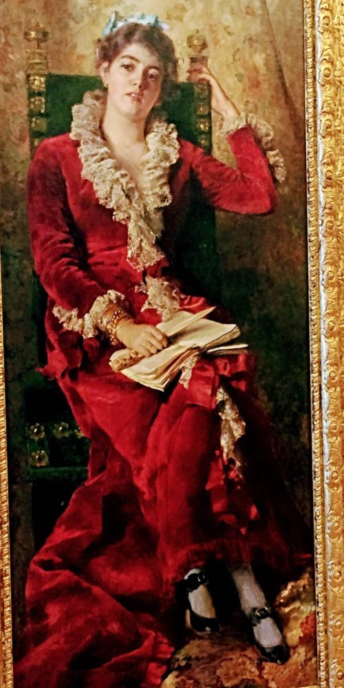 Full-length portrait of woman in red gown