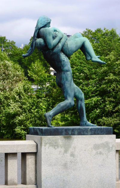 Bronze sculpture of a naked man lifting and about to throw a naked woman