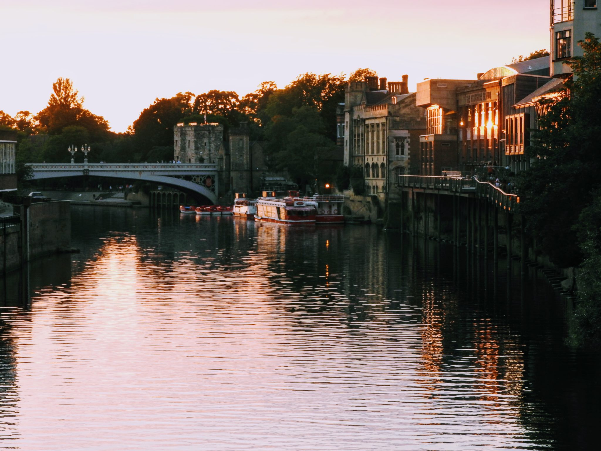 Sunset over the River Ouse in Yorkshire, seen from a bridge in the city of York.