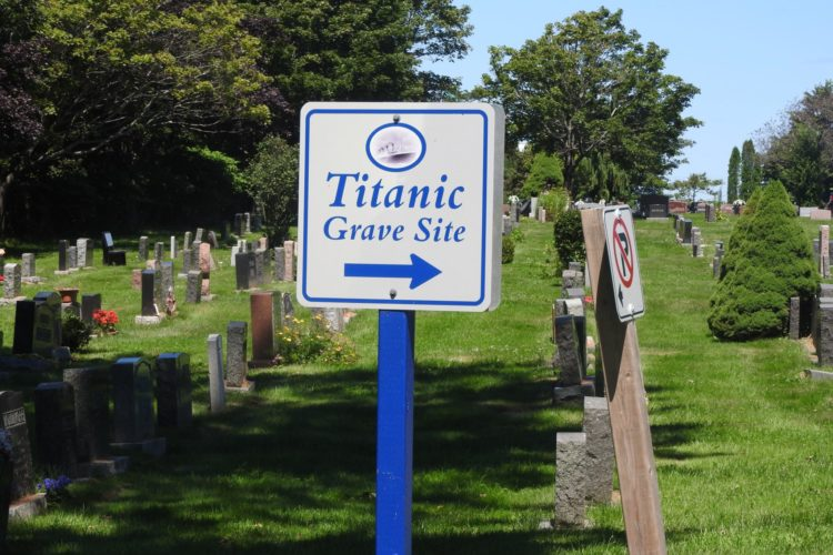 Blue & White Sign Indicating Direction To The Titanic Grave Site